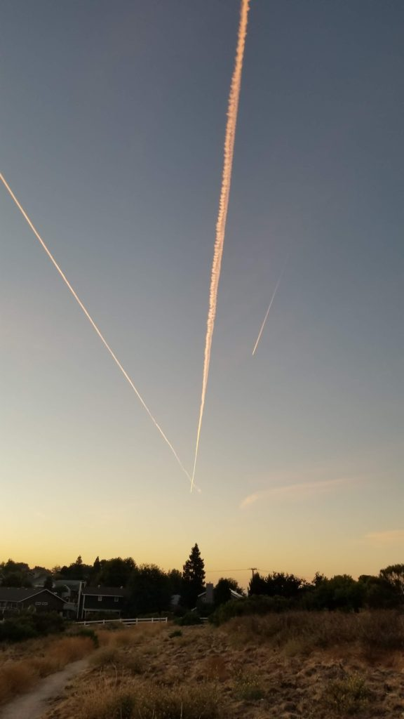 Plane trails in a morning sky