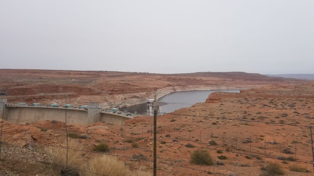 a dam over a river with canyons