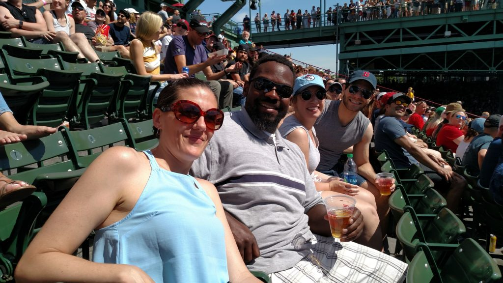 friends in the stands at Fenway park