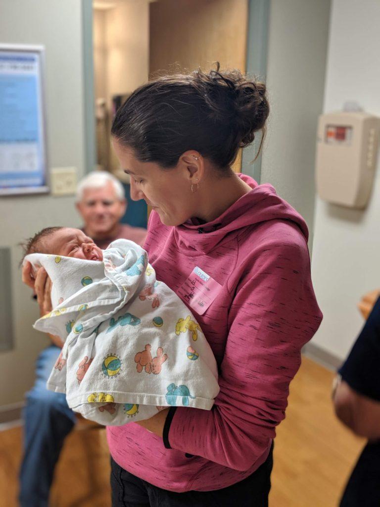 Lis holding her baby nephew