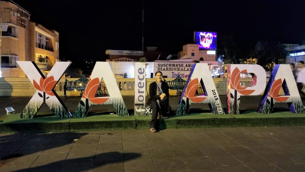 Lis manifests herself in front of Xalapa letter sign.