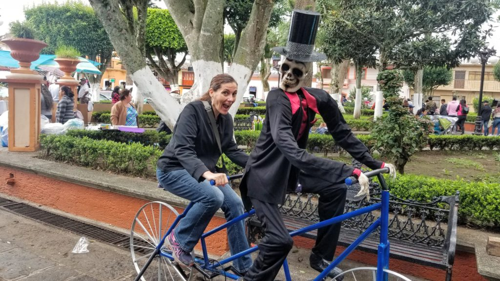 Lis on bicycle with Catrina in a tuxedo. Look, I manifested a groom!